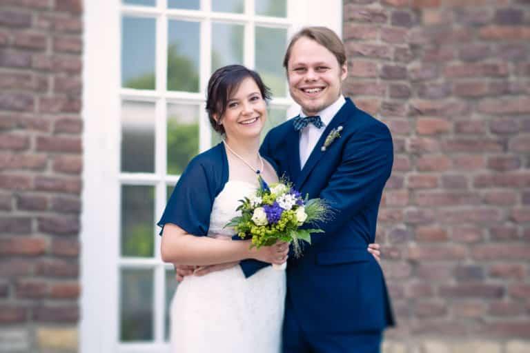 Hochzeitspaar macht Hochzeitsfotos mit Thorben dem Fotograf in Münster